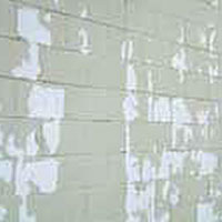 Peeling masonry coatings